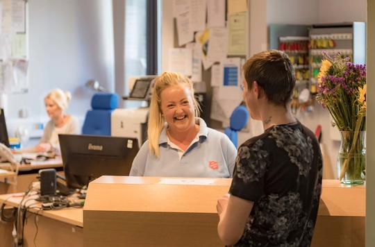 Receptionist greets service user