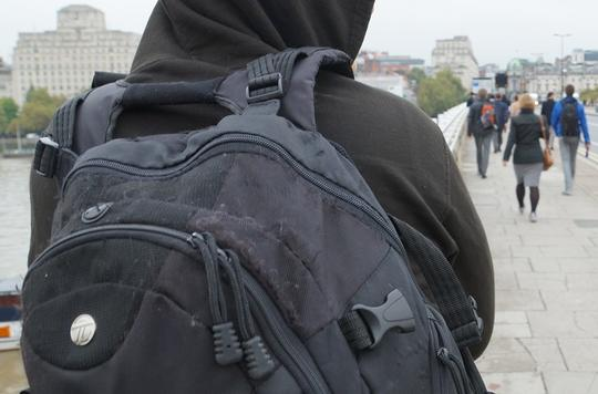 Hooded person with rucksack