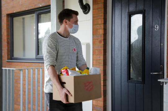 Salvation Army volunteer delivers a food parcel