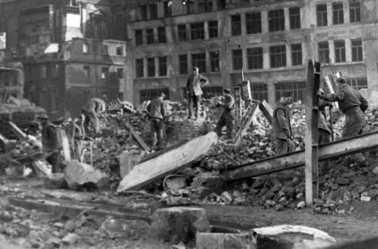 Men working among the bomb debris of The Salvation Army International Headquarters