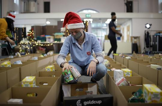 Person packing at a Christmas foodbank
