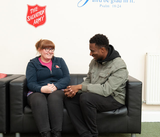 A man speaking to a Salvation Army officer at one of our centres