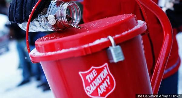 Coin jar being tipped into red plastic kettle