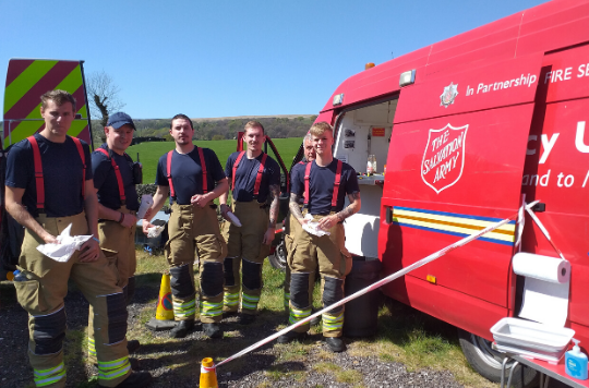Fire fighters receive refreshements from a Salvation Army van