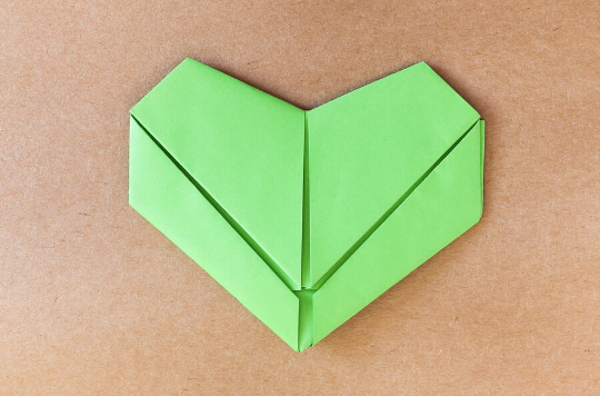 A green heart made of paper