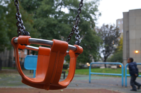 Empty child's swing at a playground