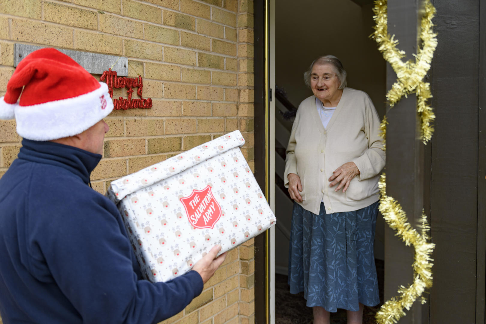 Salvation Army officer delivering meals on wheels at Christmas