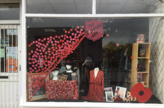 Remembrance Day window dressing at Chorley SA Charity Shop
