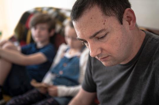 Man is worried in front of children