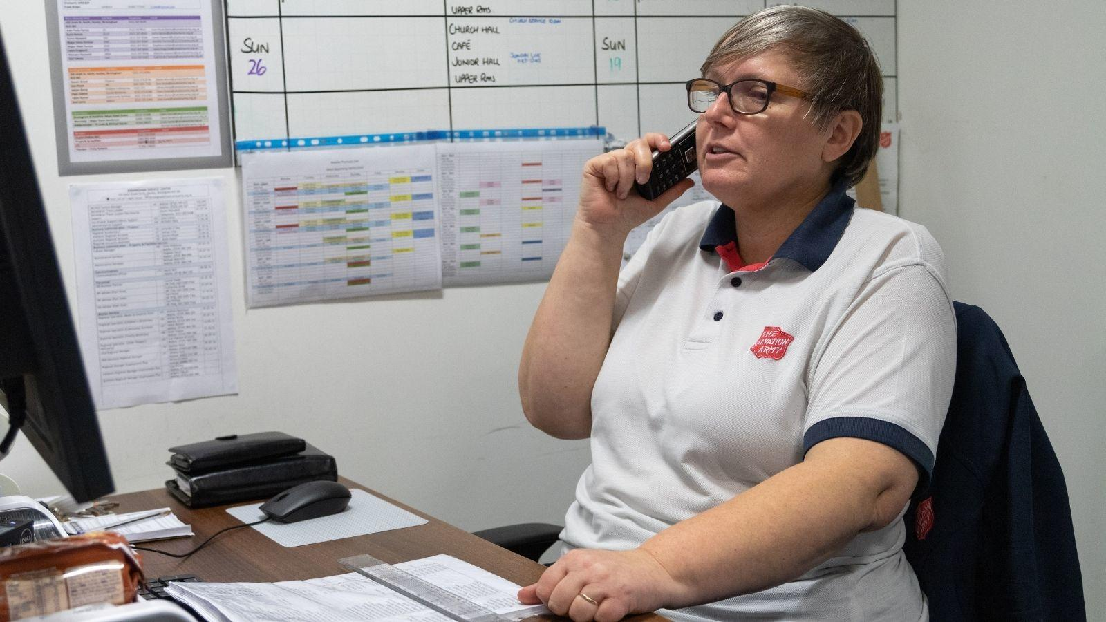 Carolyn in Droitwich speaking on the phone to an isolated older person