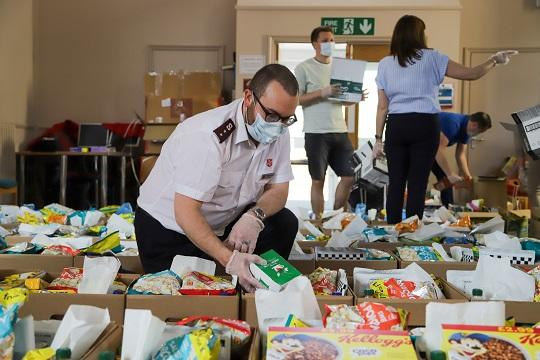 Salvation Army officer Mark Scoulding packs up food