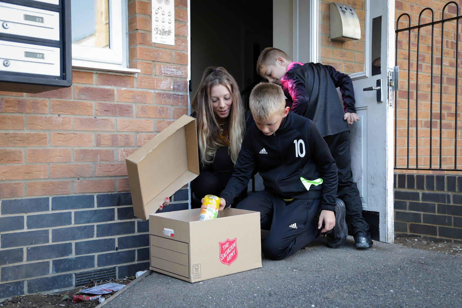 A family receive a Salvation Army food box